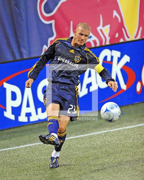 Los Angeles Galaxy super star David Beckham passes ball in the last minutes of the game against the New York Red Bulls at Giants Stadium. The score ended in a 2-2 tie.(AP Photo/Dick Druckman)