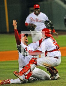 Philadelphia Phillies reliever Brad Lidge celebrates World Series Victory with catcher Carlos Ruiz and Ryan Howard. The Phillies defeated The Tampa Bay Rays 4-3.(AP Photo/Dick Druckman)