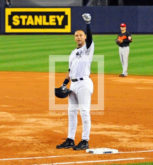 Derek Jeter waves to the crowd after breaking Lou Gehrig's franchise hit record in the third inning against the Baltimore Orioles. Derek singled over first base for his 2722nd hit.(AP Photo/Dick Druckman)