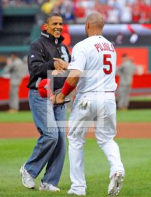President Barak Obama shakes hands with St. Louis Cardinals first baseman Albert Pulols after throwing out the first ceremonal pitch at the All Star Game. President Obama is the first president to throw out the first pitch at this event since President Gerald Ford did in 1933.(AP Photo/Dick Druckman)