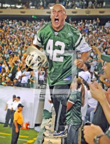 2010 FIREMAN ED ANZALONE FIRES UP THE JETS AT THEIR NEW STADIUM