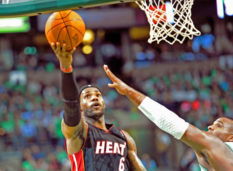 LeBron James scores two of his 31 points against the Boston Celtics in his first game of the season and first game as a Miami Heat at the Boston Garden. Despite his efforts, The Miami Heat lost 88-80.(AP Photo/Dick Druckman)