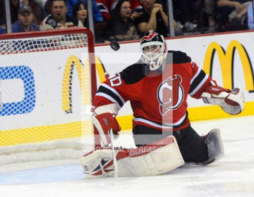 Martin Brodeur kept the Devils alive in the third period by blocking New York Rangers shot by Brad Richards. 40 year old Brodeur, blocked 33 shots on goal by the Rangers leading the Devils to a 3-2 overtime victory in game 6 of the Eastern Conference Finals to advance to their first Stanley Cup finals since 2003.(Dick Druckman)