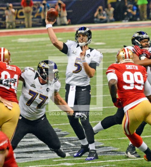 Baltmore Ravens quarterback, Joe Flacco, throws a touchdown pass to Anquan Boldin in the first quarter of the Super Bowl against the San Francisco 49ers. Flacco, who