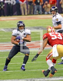 Baltimore Ravens running back Ray Rice runs for a first down in the fourth quarter as San Francisco 49ers linebacker Navorro Bowman comes up to make the tackle.
