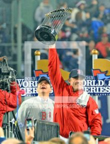 Boston Red Sox manager, John Farrell, holds up the World Series Trophy after winning game 6 by a score of 6-1. The is the first time the Red Sox have won a world series at Fenway Park since 2018
