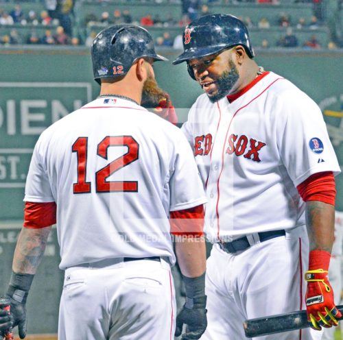 Boston Red Sox designated hitter, David Ortiz(Big Papi) pulls on Mike Napoli's beard as he makes a point in the eighth inning of game 6 if the World Series. Big Papi was selected as MVP of the Series as he went 11 for 16 for a 688 average