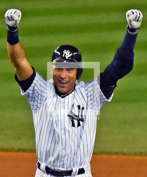 New York Yankees captain, Derek Jeter, celebrates hitting a walk-off single in the bottom of the ninth inning in his last ime at bat at Yankee Stadium. Jeter went 2 for 5, driving in 3 of the Yankees 6 runs in a 6-5 storybook ending.(