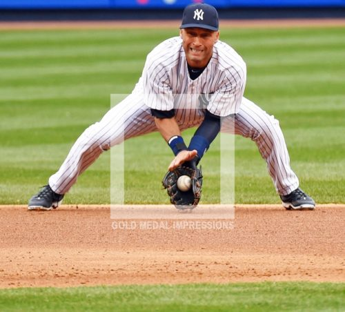New York Yankees captain Derek Jeter feilds ball and throws out runner in the top of the fourth inning against the Baltimore Orioles. The Yankees went on to win their home opener 4-2.(