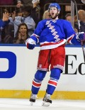 With less than a minute remaining in the second period, New York Rangers center, Derick Brassard, scores giving the Rangers a 2-1 lead going into the third period. The Rangers went on to win 3-2 in overtime.(AP Photo/Dick Druckman)