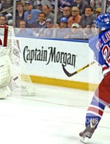 New York Rangers Martin st. Louis scores winning goal against Canadians rookie Dustin Tokarski in overtime giving the Rangers a 3-2 victory. The Rangers now head back to Montre'al leading 3-1 in round 3 of the Stanley Cup Playoffs.(AP Photo/Dick Druckman