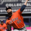Houston Astros starting pitcher, DALLAS KEUCHEL, strikes out New York Yankees Starliln Castro in the bottom of the seventh inning. KEUCHEL threw 106 pitches over 7 innings, allowing only 3 hits and 2 runs striking out 5 and walking four batters, leading the Astros to a 5-3 season opener victory.