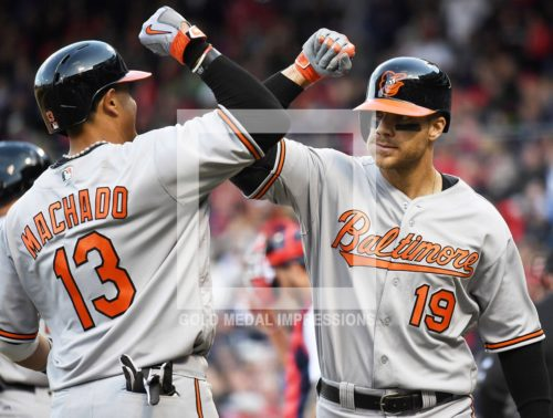 In the crowning moment of the game for the Baltimore Orioles, MANNY MACHADO high fives CHRIS DAVIS after Davis hits a three-run home run in center field off of Boston Red Sox closeer Craig Kimbrel in ninth inning to give the Orioles a 9-7 victory to begin their season 6-0, the best start in Batimore franchise history.