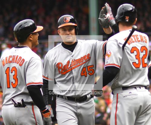 Baltimore Orlioles right fielder MARK TRUMBO is congratulated by MANNY MACHADO and MATT WIETERS after hitting a three-run home run in the third inning off of Boston Red Sox starter David Price. The Orioles went on to defeat the Boston Red Sox 9-7 to start the season 6-0 the best start in the major leages and the best start in Orioles franchise history.