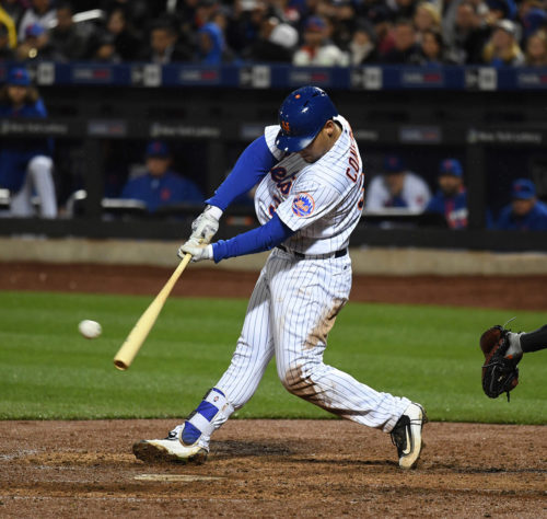 New York Mets outfielder, MICHAEL CONFORTO, singles for his second hit of the inning, driving in the 8th run of the third inning. The Mets went on to win 13-1.