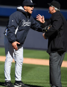 New York Yankees manager, JOE GIRARDI, argues with plate umpire, DANA DeMUTH, that Houston Astros shortstop should have been called out for running in fair territory on a dribbler to first base and a throwing error by the pitcher in the eighth inning. The tie breaking run scored and the safe call was upheld by the four umpires and Girardi played the remainder of the game under protest. The Houston Astros went on to win 5-3.