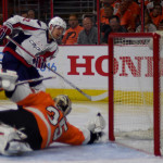 Washington Capitals center, EVGENY KUZNETSOV, scores against the Philadelphia Flyers goaltender, STEVE MASON, in the third period of game three at the Wells Fargo Center. The Capitals went on to win 6-1, taking a 3-0 lead in the series.