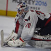 Washington Capitals goaltender, BRADEN HOLTBY, blocks a puck shot by Philadelphia Flyers Wayne Simmonds in the second period of game three at the Wells Fargo Center. HOLTBY held the Flyers to only one goal as the Capitals went on to win 6-1.