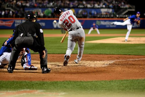 Former New York Mets second baseman, and now second baseman for the Washington Nationals, DANIEL MURPHY, hits a double off of New York Mets reliever, LOGAN VERRETT, in the fourth inning at citiFIELD. The Nationals went on to win 9-1.