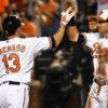 Baltimore Orioles shortstop MANNY MACHADO high fives third baseman RYAN FLAHERTY
