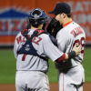 Boston Red Sox catcher CHRISTIAN VAZQUEZ talks with relief pitcher JUNICHI TAZAWA