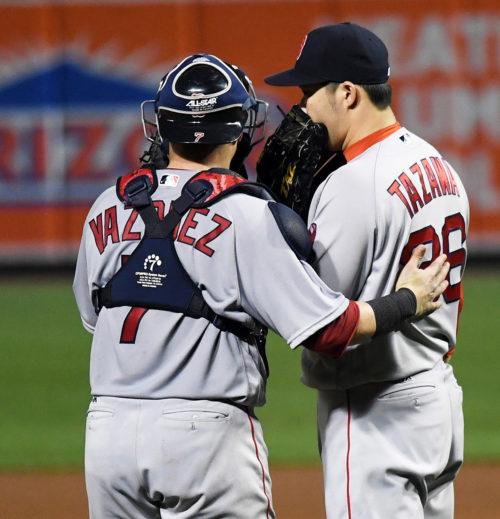 Boston Red Sox catcher CHRISTIAN VAZQUEZ talks with relief pitcher JUNICHI TAZAWA