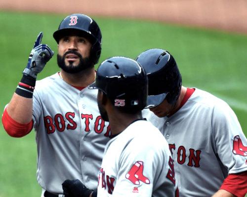 Boston Red Sox SANDY LEON celebrates hitting a home run