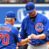 Chicago Cubs starting pitcher JOHN LESTER hands the ball to Cubs Manager JOE MADDON
