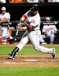 Boston Red Sox catcher, SANDY LEON, hits a two-run home run