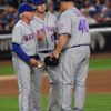New York Mets starting pitcher BARTOLO COLON hands the ball off to Mets manager TERRY COLLINS