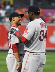 Red Sox DAVID ORTIZ(BIG PAPI) embraces Mookie Betts