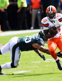 Cleveland Browns quarterback ROBERT GRIFFIN III evades Eagles linebacker MYCHAL KENDRICKS