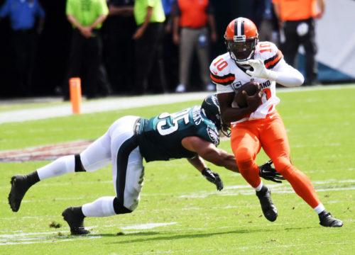 Cleveland Browns quarterback ROBERT GRIFFIN III evades Eagles linebacker MYCHAL KENDRICKS