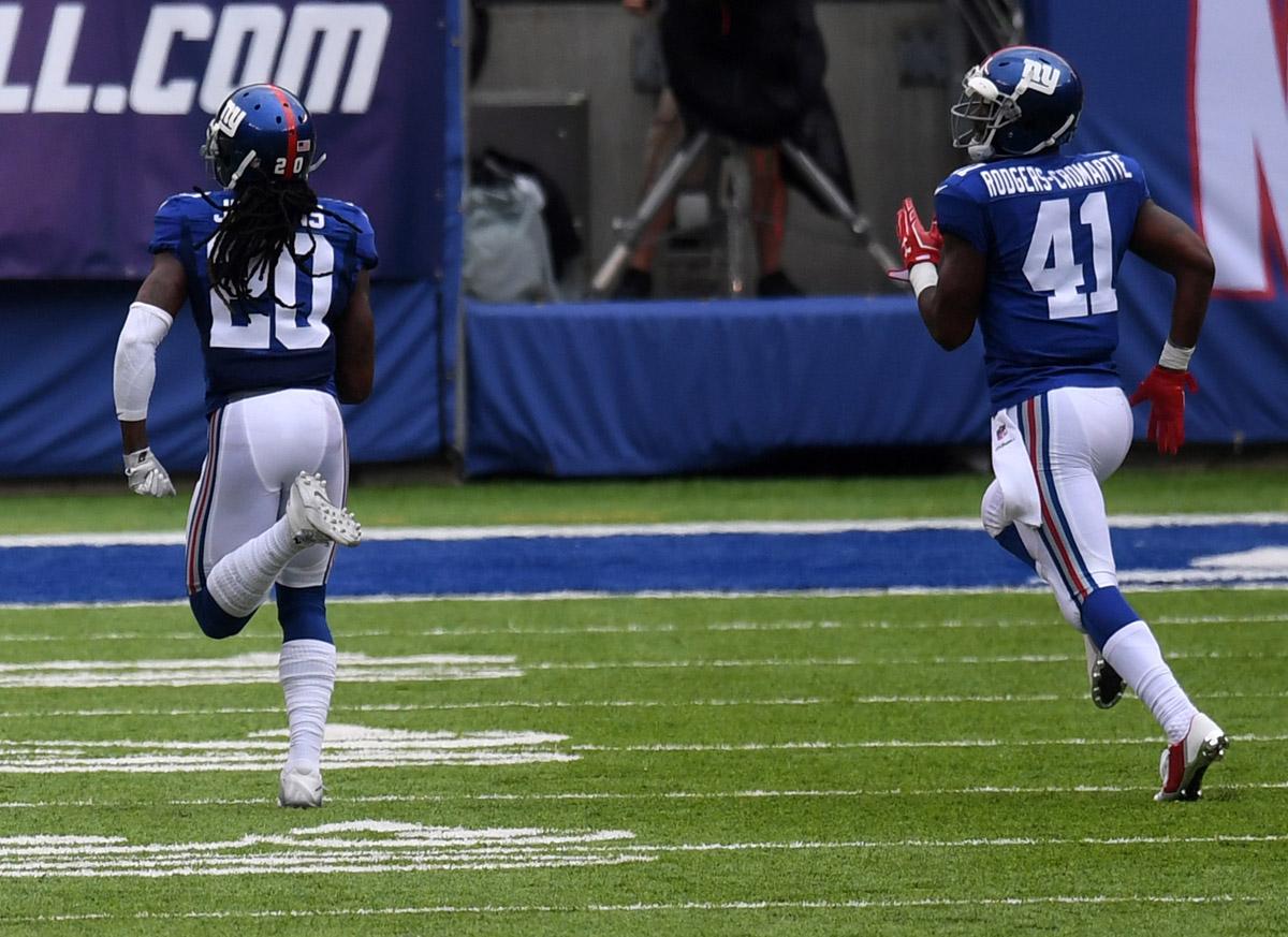 New York Giants cornerback JANORIS JENKINS returns a blocked field