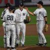 New York Yankees manager JOE GIRARDI takes the ball from BRYAN MITCHELL