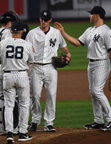 New York Yankees manager JOE GIRARDI takes the ball from BRYAN MITCHELL