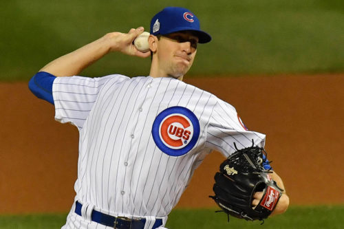 Chicago Cubs starting pitcher KYLE HENDRICKS throws a stike