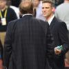 Chicago Cubs General Manager THEO EPSTEIN talks with sports announcer Chris Berman