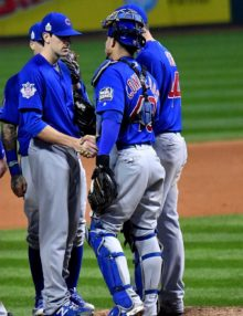 Chicago Cubs catcher WILSON CONTRERAS shakes the hand of starting pitcher KYLE HENDRICKS