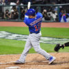 Chicago Cubs catcher and designated hitter KYLE SCHWARBER hits a single