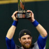Chicago Cubs outfielder BEN ZOBRIST holds up his MVP trophy