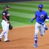 Chicago Cubs outfielder DEXTER FOWLER rounds third base after hitting a home run