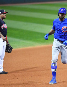 Chicago Cubs outfielder DEXTER FOWLER rounds third base after hitting a home run