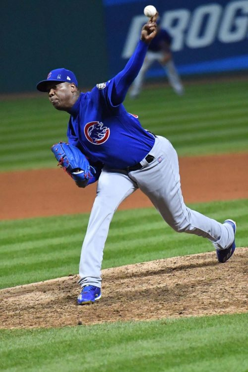 Chicago Cubs relief pitcher AROLDIS CHAPMAN pitches to Indians pinch hitter Brandon Guyer bottom of the 9th