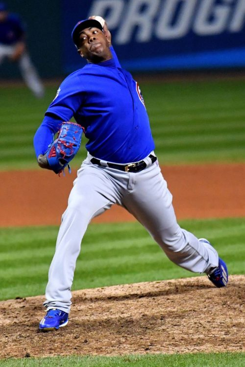 Chicago Cubs relief pitcher AROLDIS CHAMPMAN throws a strike