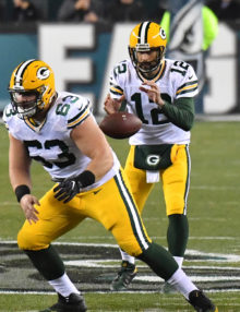 Green Bay Packers quarterback AARON RODGERS takes the snap