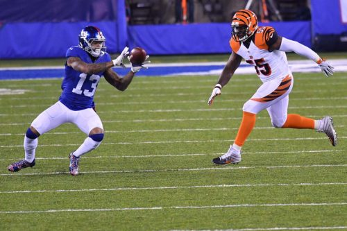 Giants ODELL BECKHAM JR. receives a pass from Eli Manning