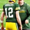 Green Bay Packers head coach MIKE McCARTHY discusses strategy with AARON ROGERS