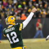 Green Bay Packers quarterback AARON ROGERS completes pass