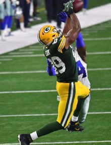 Green Bay Packers tight end JARED COOK makes a leaping catch